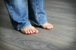 flat feet on a wooden floor