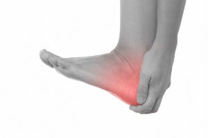 Person holding heel in pain