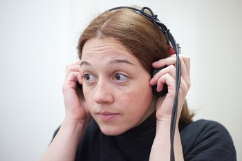 Girl taking yearly hearing test