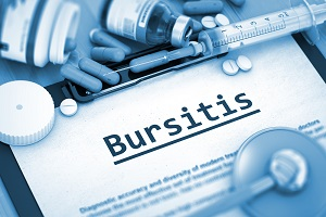 Medical diagnosis of bursitis is noted on a clipboard