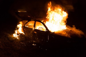 A traffic collision leaves a car on fire