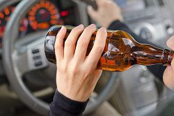 How would changing the drinking age affect road safety and drunk-driving rates?