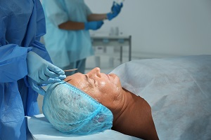 Facial surgery begins for a car accident victim