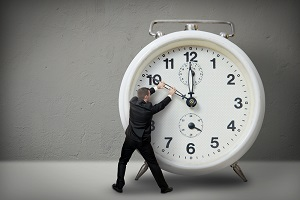 Man manipulates the hands of a giant clock