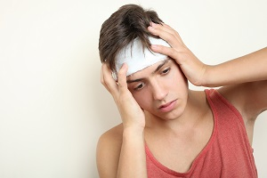 Young man with a bandaged head injury