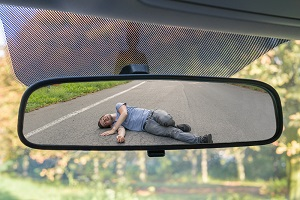 Hit-and-run victim is seen in a rear-view mirror