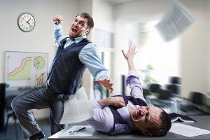 A fistfight breaks out between two office workers