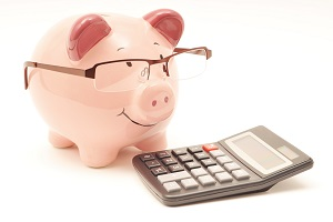 Piggy bank with spectacles and calculator