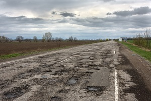 Pits and potholes along a country road
