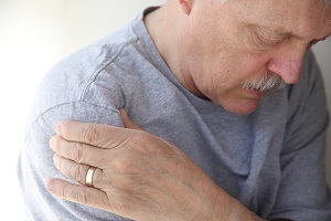 Older man suffers from shoulder pain