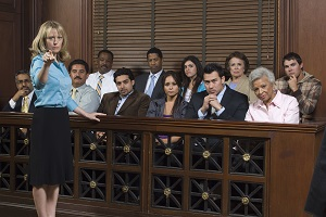 Female attorney stands in front of a skeptical jury