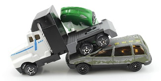 Truck crash is illustrated with toy vehicles