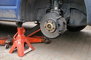 A truck's disc braking system is under repair