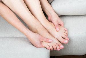 Person examining feet