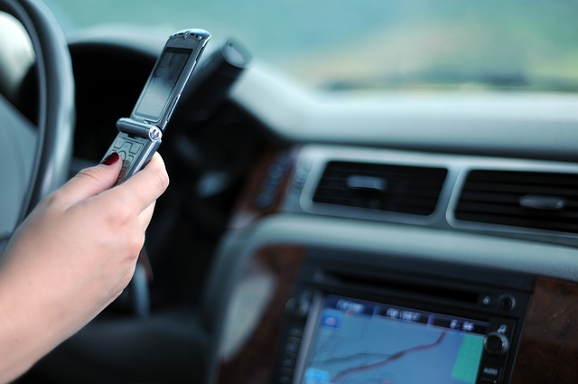 What are the penalties for texting and driving?