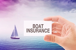 Hand Holding a Generic Boat Insurance Card