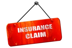 Red Metal Insurance Claim Sign