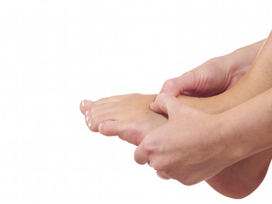Holding sore foot