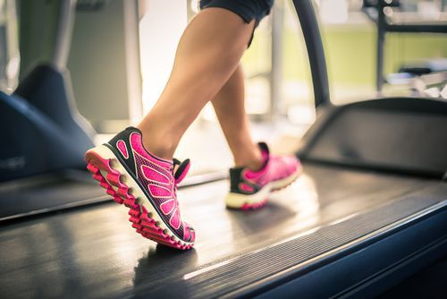 feet of woman exercising on treadmill