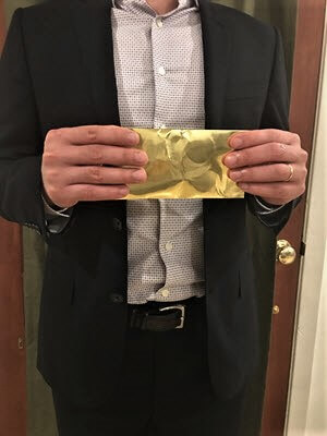 Man Holding Golden Envelope