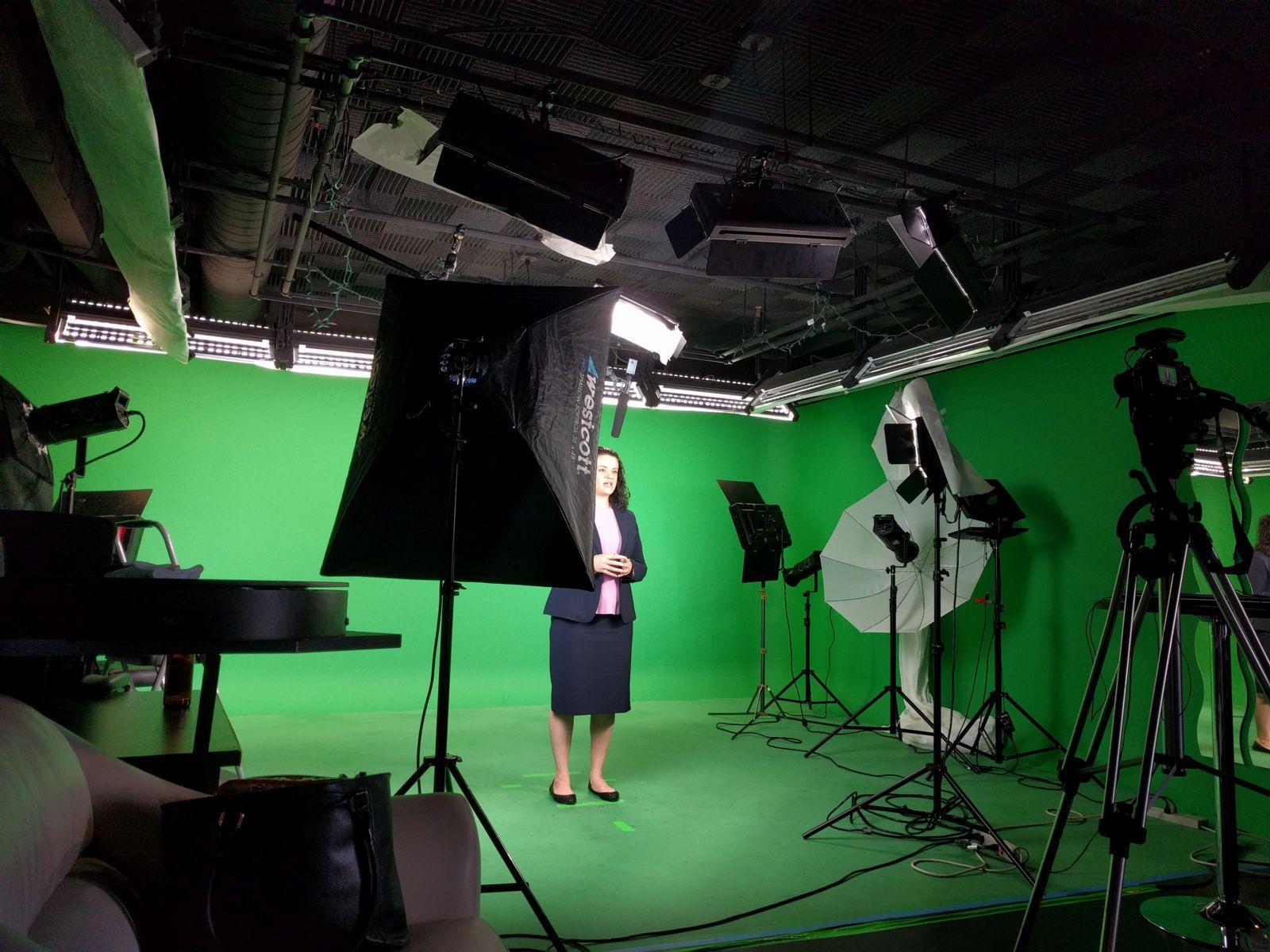 Attorney Jackie Bedard's in a green screen video studio