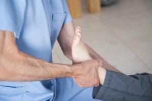 Doctor Examining a Diabetic Foot