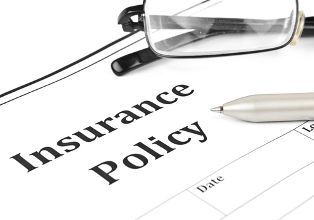 Insurance Policy Form With Glasses and a Pen