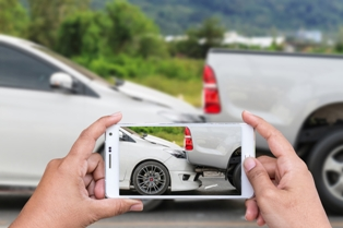 person taking picture of a rear-end accident