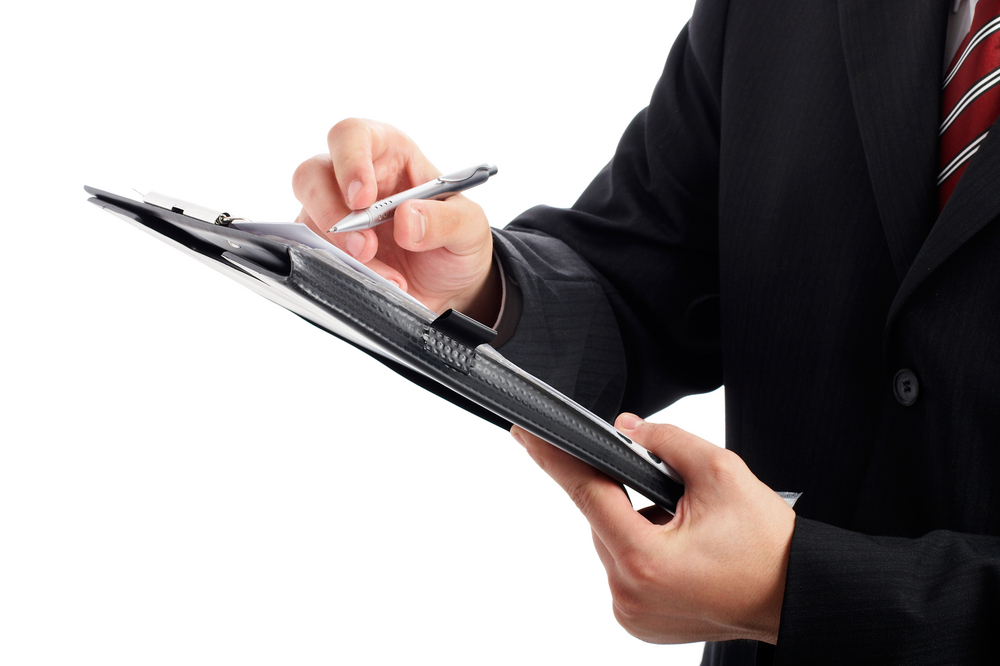 Close-up of man holding clipboard