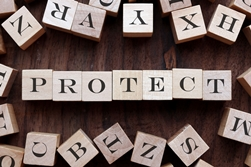 Protect Spelled Out With Wooden Block Letters
