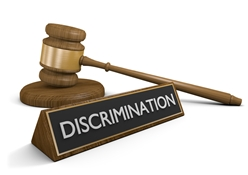 A Gavel Behind a DISCRIMINATION Sign