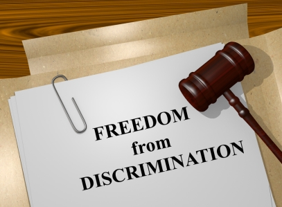 Pile of papers with the words 'Freedom From Discrimination' printed on them
