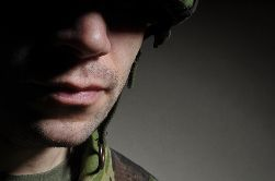 A Close-Up of a Soldier Standing in the Shadows
