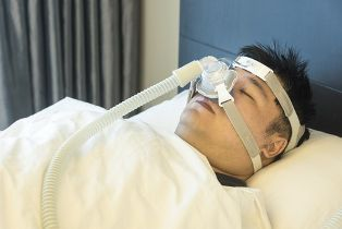A Sleeping Veteran Wearing a CPAP Mask