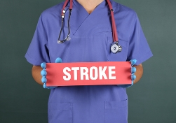Medical Personnal Holding a Red Stroke Sign