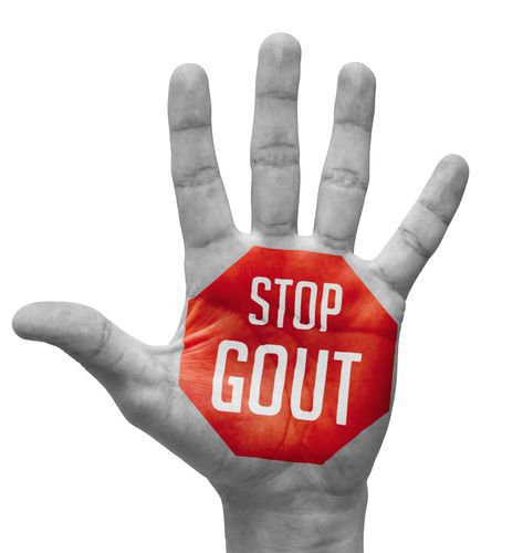 Hand With a Stop Gout Sign Painted in Red