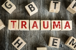 Trauma Spelled Out With Red Block Letters