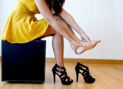 Woman with foot pain because of high heels