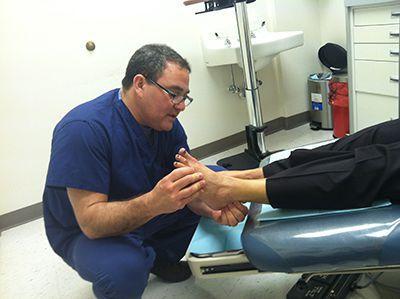 Dr. Joel Brook Examining Patient's Foot