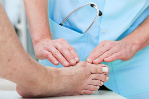 Doctor checking patient with a bunion