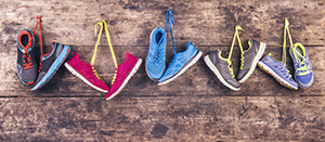 Running shoes hanging on a wooden wall