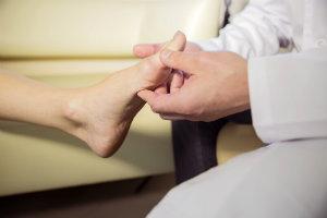 podiatrist holding a patient's foot