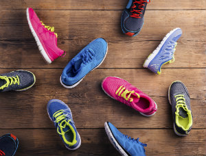 An assortment of running shoes on a wooden floor