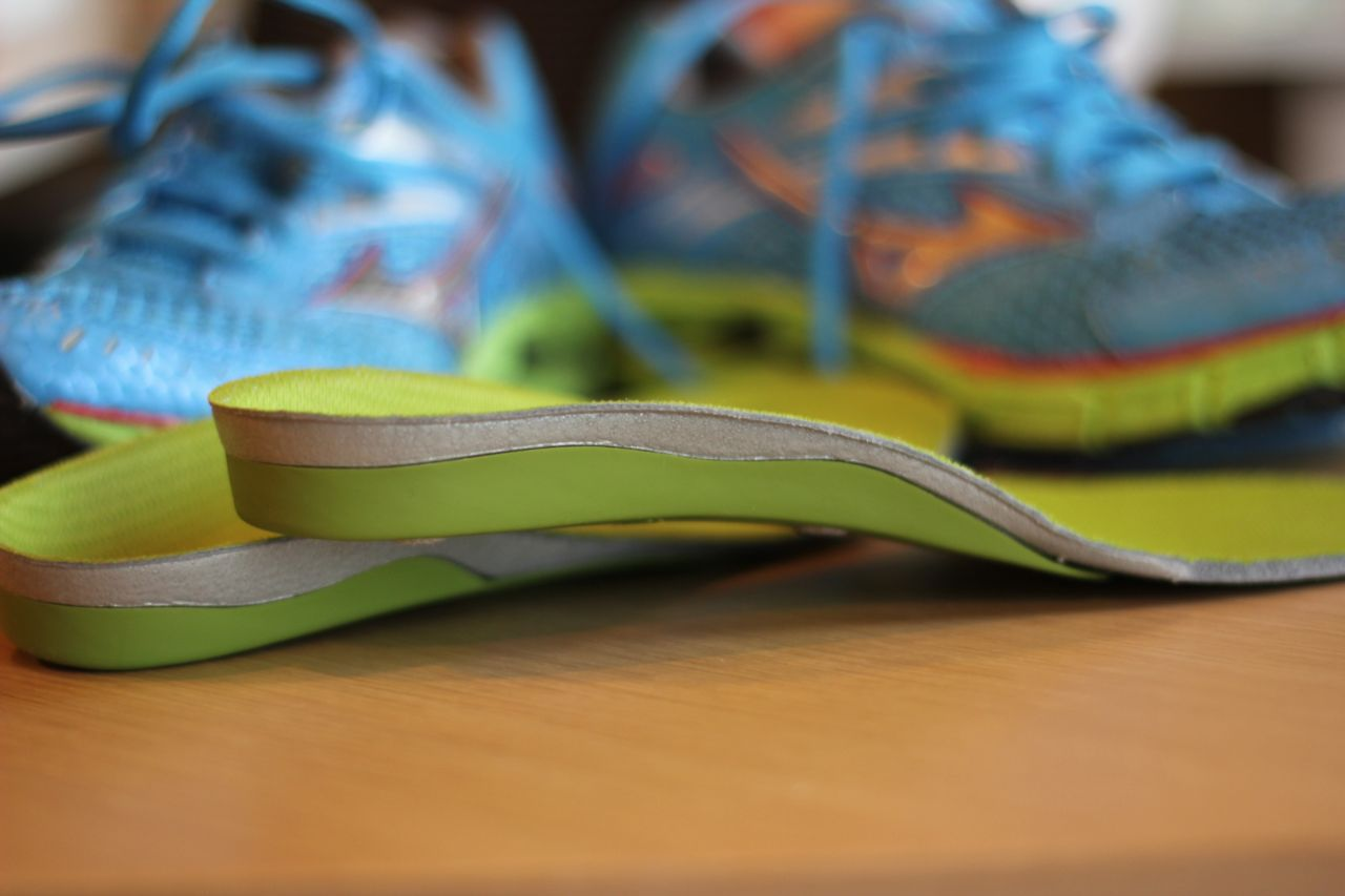 How can orthotics help with sore feet?