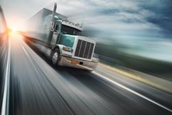Speeding Semi-Truck on a Busy Highway