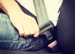 Close-Up View of an Adult Fastening His Seat Belt