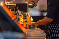 A Bartender Pouring an Alcoholic Drink