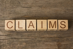 Claims Spelled Out With Wooden Blocks