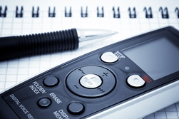Close-Up View of a Voice Recorder and a Pen