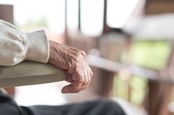 An Elderly Nursing Home Patient Sitting in a Chair